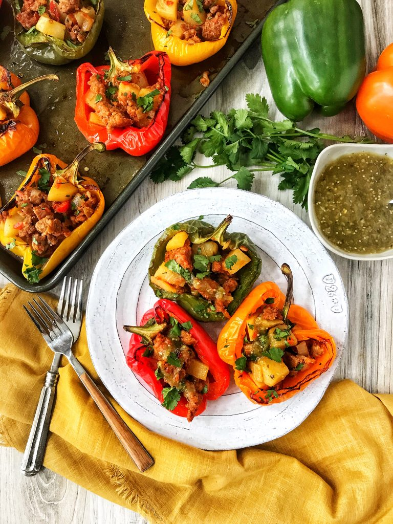 Red, green and orange bell peppers stuffed with chorizo con papas.