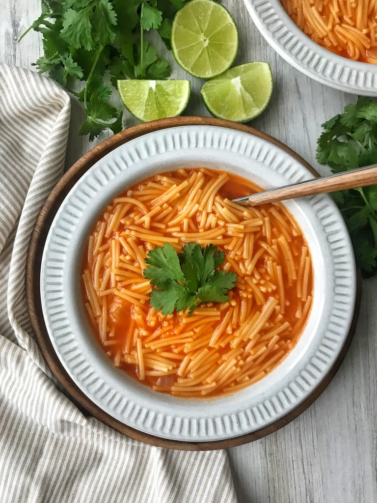 Mexican Fideo with cilantro and lime garnish