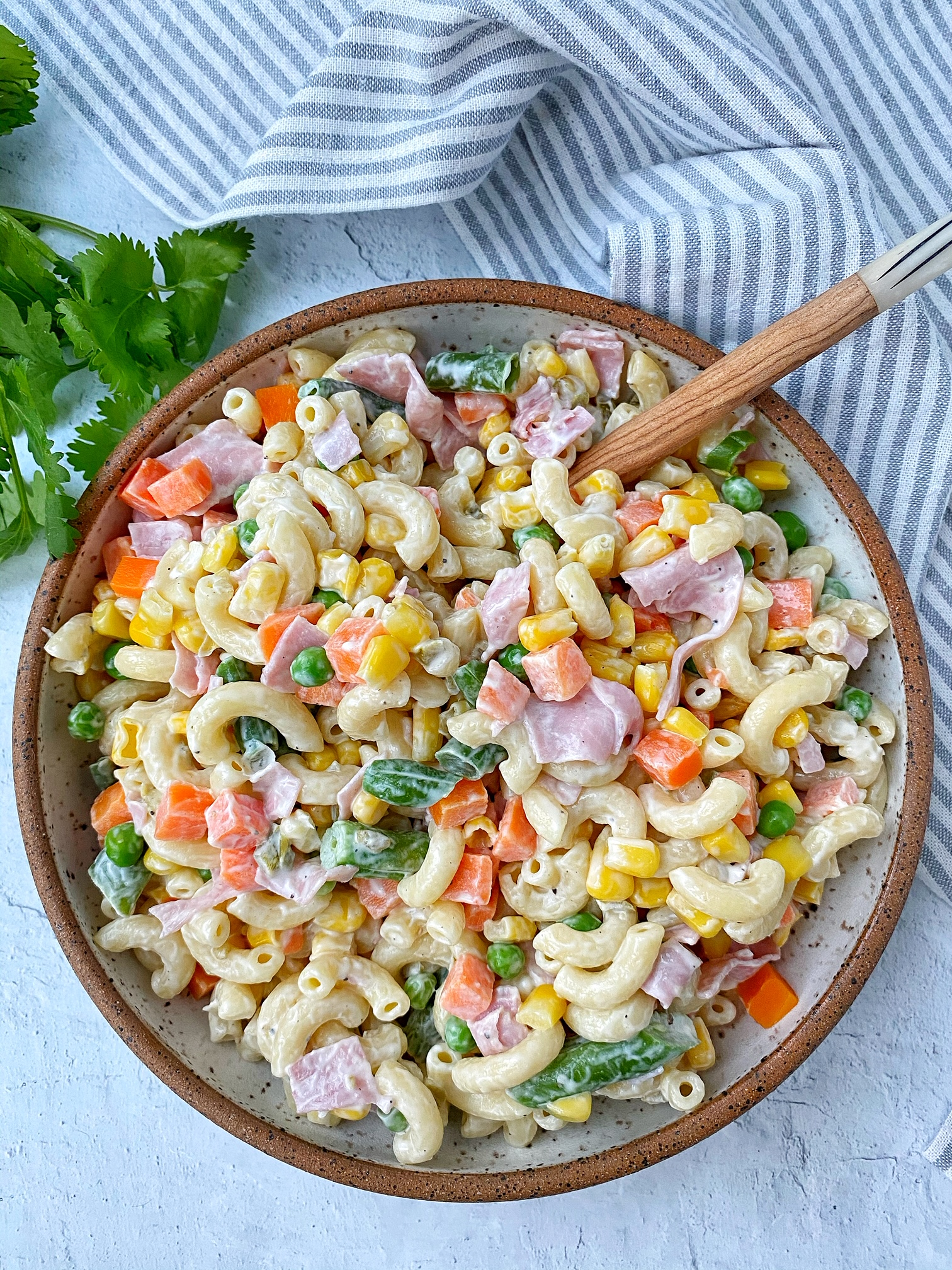 Bowl with macaroni salad. Cilantro garnish