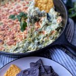 pan of spinach poblano dip with tortilla chips