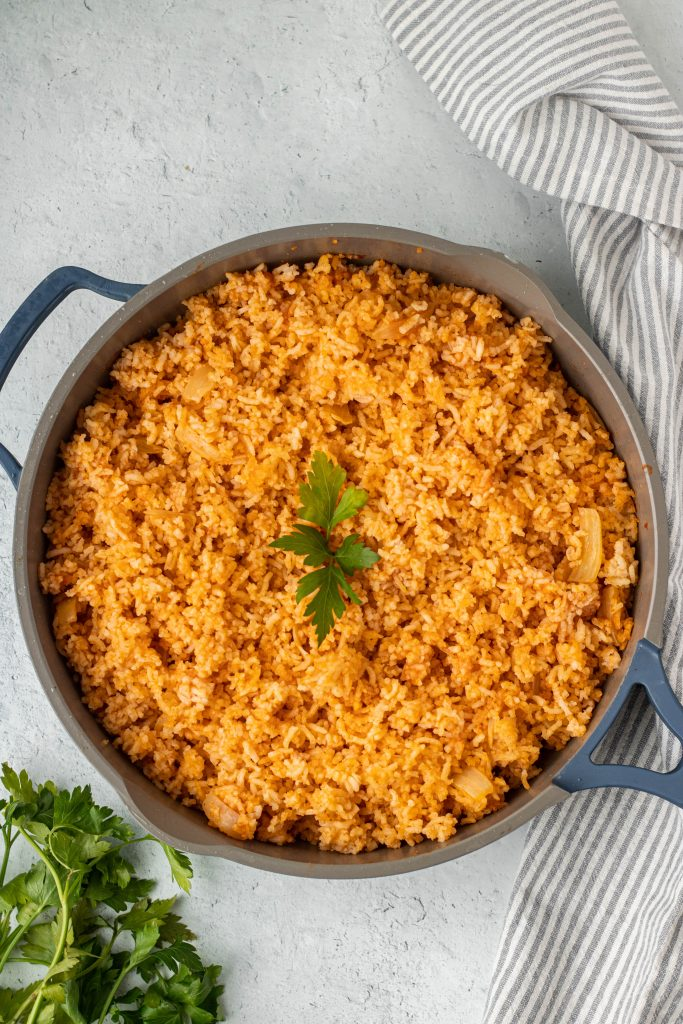 Pan with Authentic Mexican rice, cilantro garnish